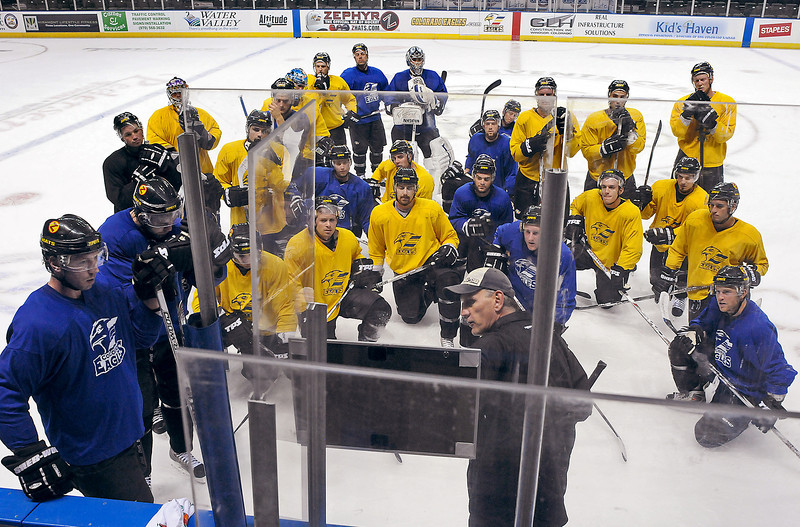 The Colorado Eagles listen to head coach Kevin McClelland during their first practice on Monday at the Budweiser Events Center in Loveland.