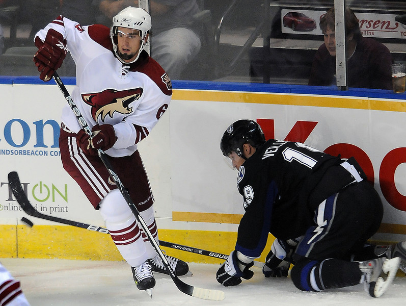Defenseman David Schlemko of the Phoenix Coyotes takes the puck away from Stephane Veilleux of the Tampa Bay Lightning during a National Hockey League exhibition game on Wednesday night at the Budweiser Events Center.