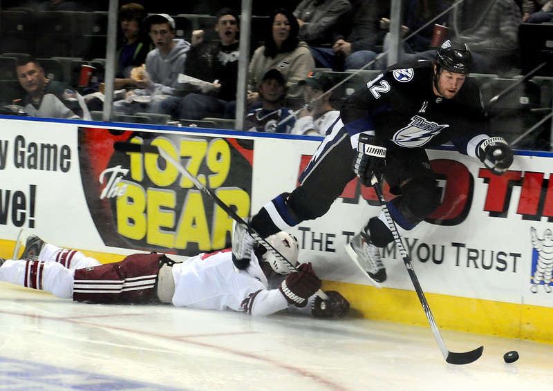 Ryan Malone of the Tampa Bay Lightning takes to the air over Peter Mueller of the Phoenix Coyotes during a National Hockey League exhibition game on Wednesday night at the Budweiser Events Center.