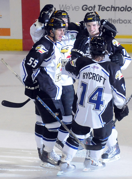 Colorado Eagles players celebrate after a goal during a recent game against the Bossier-Shreveport Mudbugs at the Budweiser Events Center.