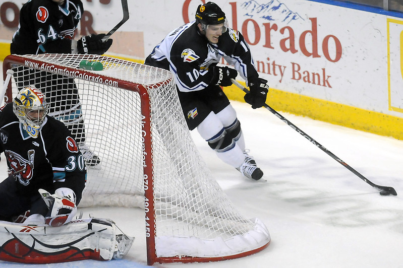 Colorado Eagles winger Steve Haddon skates behind the net with the puck as Bossier-Shreveport Mudbugs goalie Brian Foster looks on in the first period of their game on Saturday, Jan. 8, 2011 at the Budweiser Events Center.
