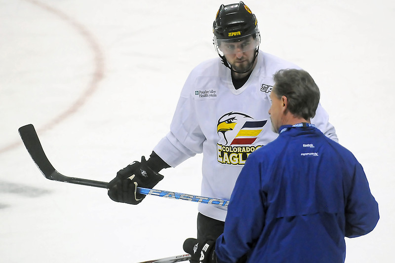 Newly signed Colorado Eagles forward Dan Sullivan listens to head coach Chris Stewart during practice Wednesday morning at the Budweiser Events Center.