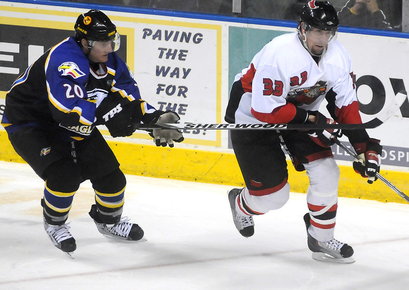 Colorado Eagles defenseman Jason Beatty, left, during a game against the Odessa Jackalopes on March 3, 2010 at the Budweiser Events Center.