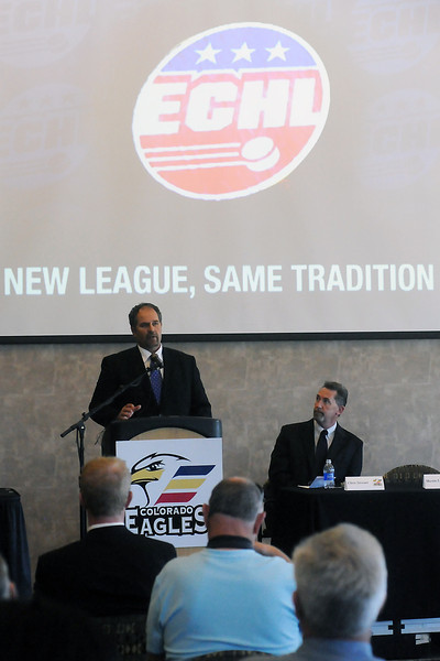 Colorado Eagles head coach and general manager Chris Stewart, back right, looks on as Eagles majority owner Martin Lind speaks during a news conference Tuesday at the Budweiser Events Center announcing that the team would leave the Central Hockey League next season to join the East Coast Hockey League.