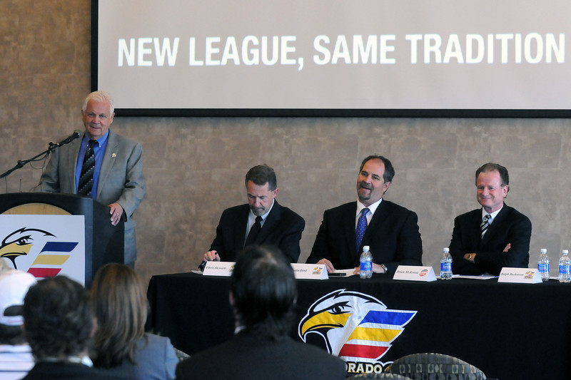 Colorado Eagles team founder Ralph Backstrom, back left, speaks during a news conference announcing the team's move next season from the Central Hockey League to the East Coast Hockey League.