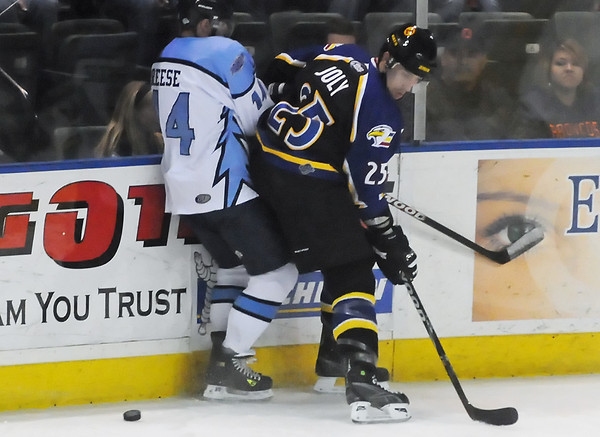 Colorado Eagles defenseman Mario Joly battles against the boards with Jason Reese of the Wichita Thunder during their game on Saturday, March 6, 2010 at the Budweiser Events Center.