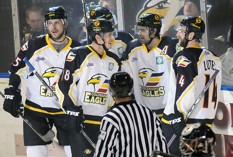 Colorado Eagles players celebrate a goal by Ed McGrane, second from right, in the second period of their playoff game against the Bossier-Shreveport Mudbugs on Friday, March 26, 2010 at the Budweiser Events Center.