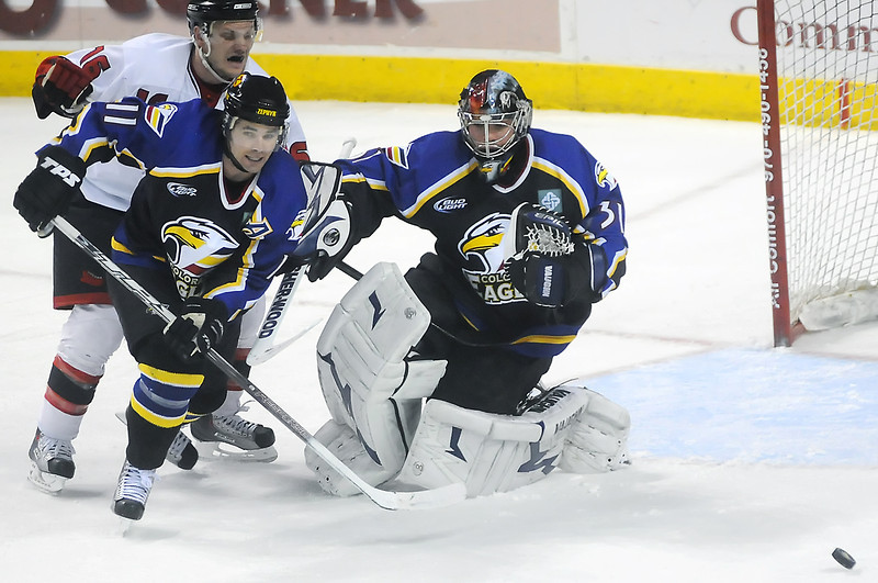 Colorado Eagles goalie Andrew Penner and teammate Ed McGrane protect the net from Odessa Jackalopes forward Colllin Circelli in the second period of their game on Wednesday, March 3, 2010 at the Budweiser Events Center.