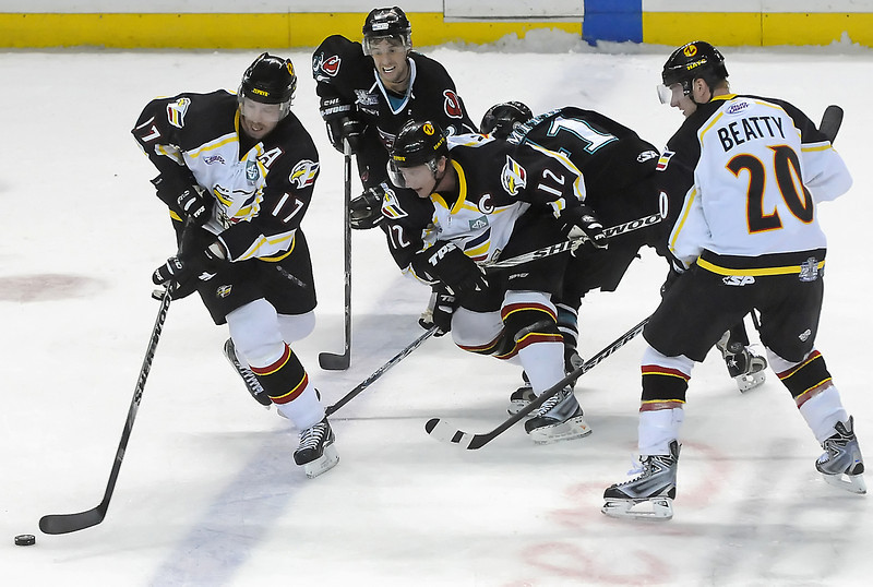 Colorado Eagles players Ryan Tobler, left, Riley Nelson and Jason Beatty battle against Joe Ori, back left, and Brett Smith of the Bossier-Shreveport Mudbugs in the first period of their playoff game on Friday, March 26, 2010 at the Budweiser Events Center.