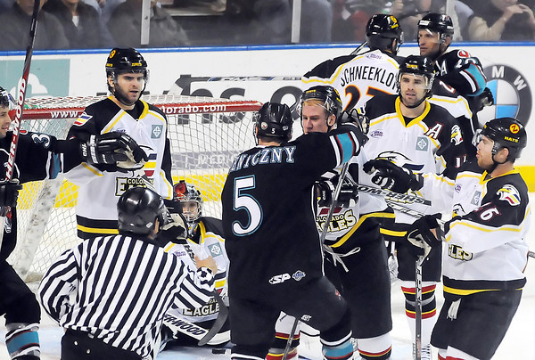 Colorado Eagles and Bossier-Shreveport Mudbugs players tussle in the second period of their playoff game on Saturday, March 27, 2010 at the Budweiser Events Center.