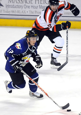 Colorado Eagles center Riley Nelson, bottom, skates away from Fort Wayne Komets forward Dan Lapointe in the first period of their game Friday at the Budweiser Events Center.
