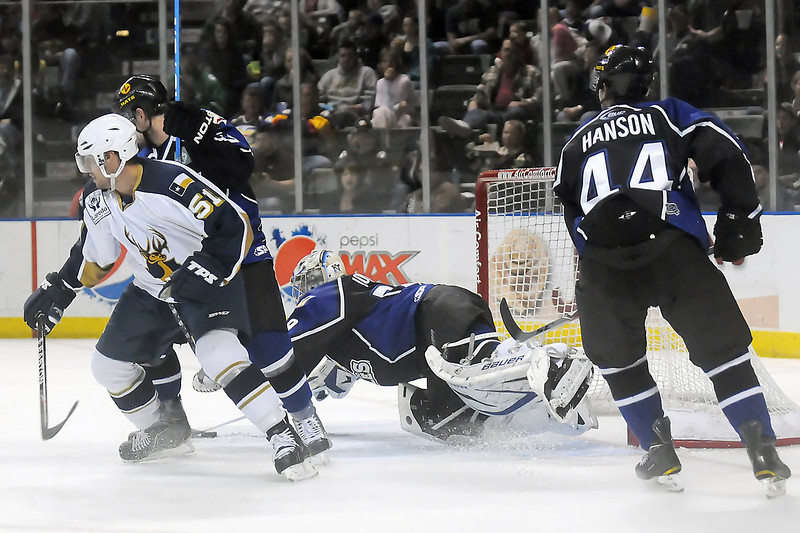 Colorado Eagles goalie Kyle Jones covers up the puck while Laredo Bucks forward Joe Scali, left, goes against defensemen Matt Hanson, right, and Kyle Peto in the second half of their game Wednesday, March 16, 2011 at the Budweiser Events Center. Jones stopped all 25 Bucks shots in the Eagles' 5-0 victory.