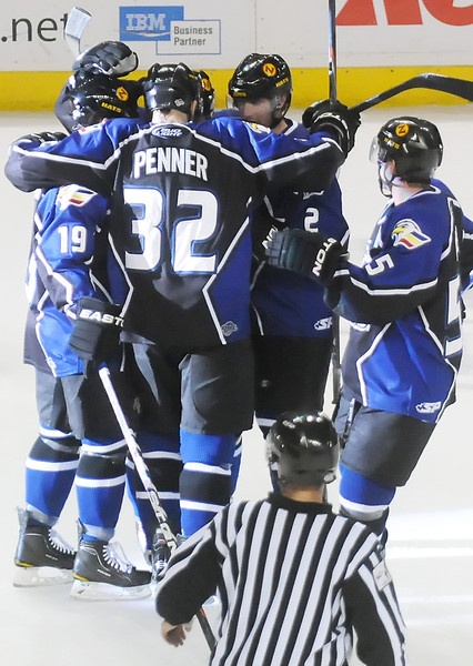 Colorado Eagles players celebrate after a goal by Kip Workman (2) in the first period of their game Friday night against the Rio Grande Valley Killer Bees at the Budweiser Events Center.