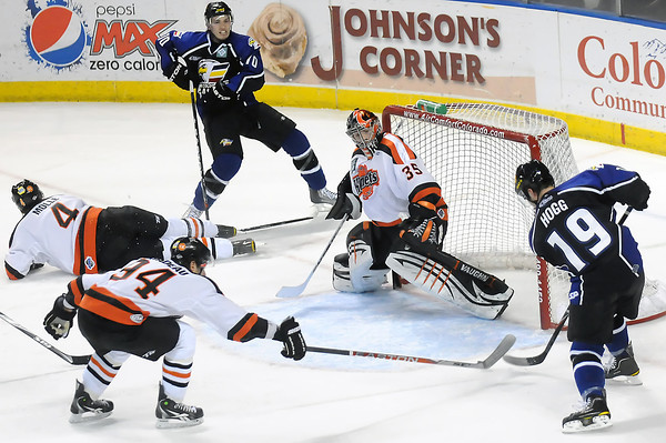 Colorado Eagles winger Steve Haddon, top, looks on as teammate Adam Hogg scores a goal against Fort Wayne Komets goalie Kevin Reiter in the first period of their game Friday at the Budweiser Events Center.