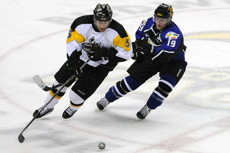 Colorado Eagles forward Joey Sides, right, and Stockton Thunder defenseman Mike Little track down the puck in the first period of their game Tuesday, March 6, 2012 at the Budweiser Events Center.