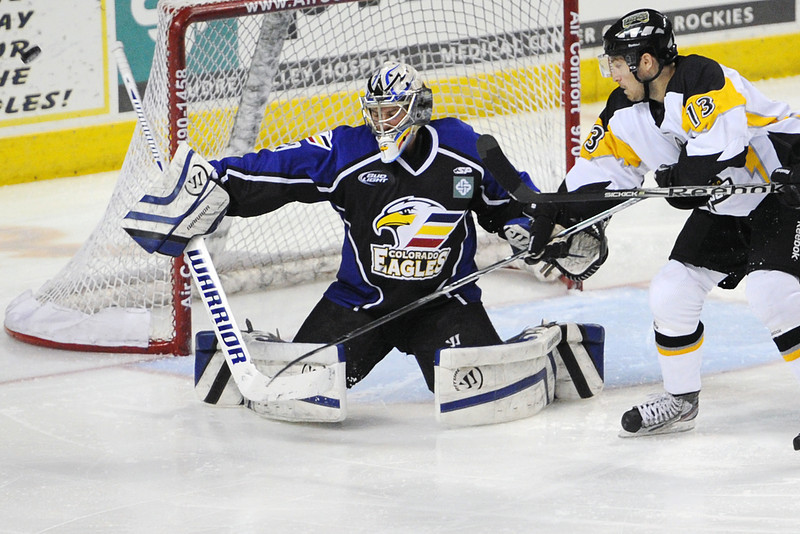 Colorado Eagles goalie Kyle Jones defelcts a shot in front of Stockton Thunder winger Jesse Fratkin in the second period of their game Tuesday, March 6, 2012 at the Budweiser Events Center.