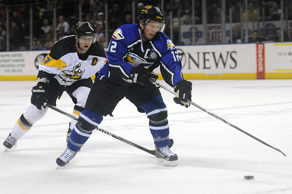 Colorado Eagles forward Riley Nelson, right, tracks down the puck ahead of Stockton Thunder center Jason Morgan in the first period of their game Wednesday, March 7, 2012 at the Budweiser Events Center.