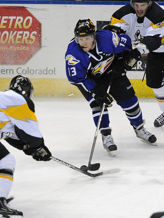 Colorado Eagles forward Chad Costello, middle, skates between Stockton Thunder defensemen Nathan Deck, left, and Cameron Brodie in the first period of their game Tuesday, March 6, 2012 at the Budweiser Events Center.