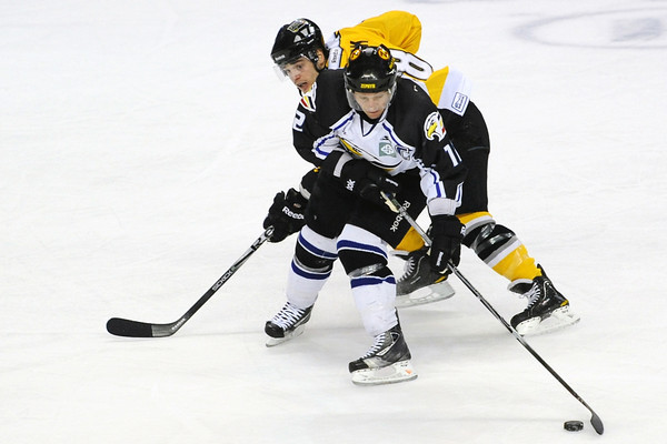 Colorado Eagles forward Riley Nelson, front, and Stockton Thunder defenseman Nathan Deck track down the puck in the first period of their game Friday, April 6, 2012 at the Budweiser Events Center.