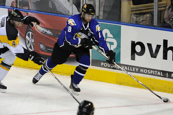 Colorado Eagles forward Patrick Cey, right, skates away from Stockton Thunder defenseman Jody Pederson in the second period of their game Tuesday, March 6, 2012 at the Budweiser Events Center.