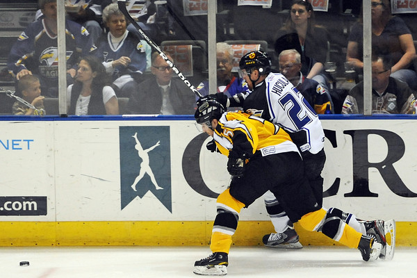 Colorado Eagles forward Liam Huculak, right, battles against the boards with Stockton Thunder defenseman Mile Little in the first period of their game Friday, April 6, 2012 at the Budweiser Events Center.
