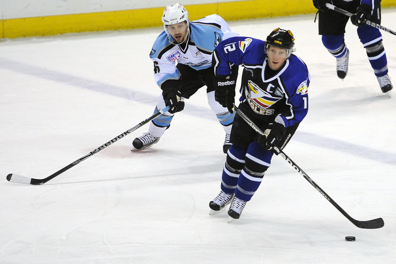 Colorado Eagles forward Riley Nelson, right, skates ahead of Alaska Aces forward Dan Kissel in the first period of their game on Friday, March 16, 2012 at the Budweiser Events Center.