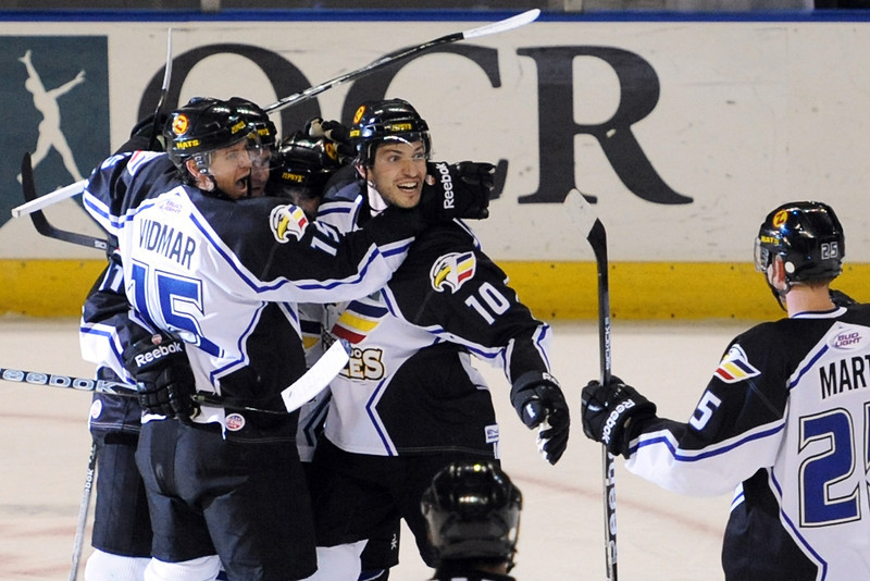Colorado Eagles forward Steve Haddon, middle, is congratulated by teammates after scoring a goal in the first period of their game against the Stockton Thunder on Friday, April 6, 2012 at the Budweiser Events Center.
