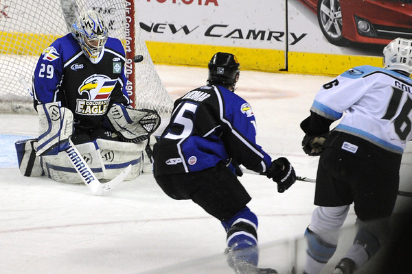 Colorado Eagles goalie Kyle Jones stops a shot by Alaska Aces winger Wes Goldie in the first period of their game on Friday, March 16, 2012 at the Budweiser Events Center.