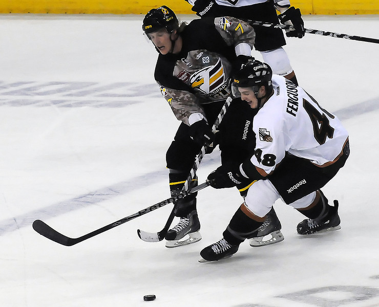 Colorado Eagles forward Michael Forney, left, collides with Utah Grizzlies winger Brett Ferguson as they track down the puck in the first period of their game on Wednesday, Nov. 9, 2011 at the Budweiser Events Center.