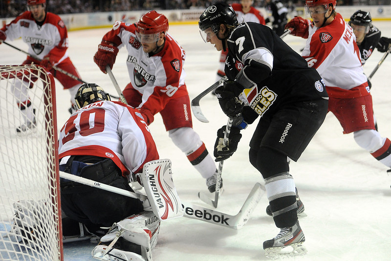 Colorado Eagles forward Michael Forney (7) works in front of the net against Las Vegas Wranglers goalie Joe Fallon in the second period of their game on Friday, March 15, 2013 at the Budweiser Events Center.