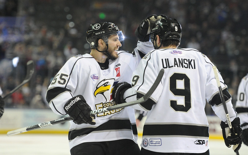 Colorado Eagles forward Steve Haddon, left, congratulates Kevin Ulanski after scoring a goal in the second period of a Colorado Eagles playoff hockey game, Sunday evening at the Budweiser Event Center in Loveland, Colo.