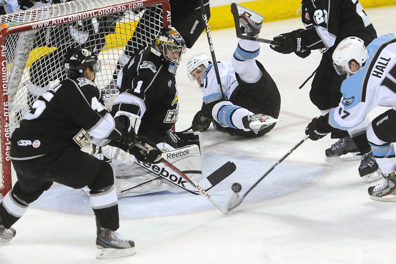Colorado Eagles forward Trent Daavettila, left, and goalie Adam Brown defend against a shot by Alaska Aces forward Tim Hall in the second period of their game Friday, March 22, 2013 at the Budweiser Events Center.