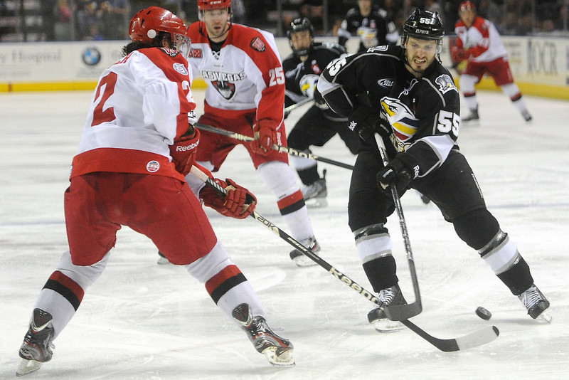Colorado Eagles forward Steve Haddon, right, goes up against Las Vegas Wranglers defenseman Jamie Fritsch in the second period of their game on Friday, March 15, 2013 at the Budweiser Events Center.