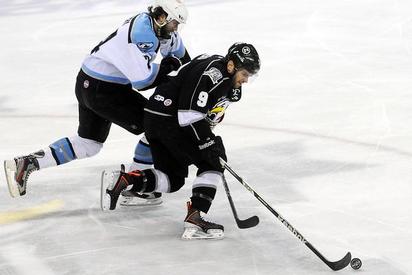 Colorado Eagles forward Kevin Ulanski (9) skates away from Alaska Aces defenseman Sean Curry in the second period of their game on Friday, March 22, 2013 at the Budweiser Events Center.