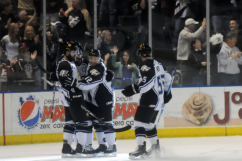 Colorado Eagles players celebrate together after a goal by Kevin Ulanski in the first period of their game against the Bossier-Shreveport Mudbugs on Wednesday night at the Budweiser Events Center.
