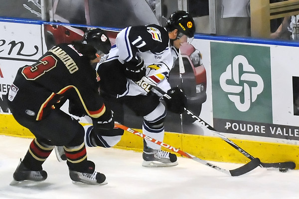 Colorado Eagles forward Matt Glasser (11) battles against the boards with Rapid City rush defenseman Gio Flamminio in the second period of their game Thursday, May 5, 2011 at the Budweiser Events Center in Loveland, Colo.