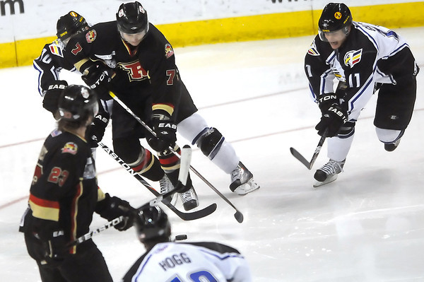Colorado Eagles players Matt Glasser, right, and Steve Haddon, back left, battle for the puck with Rapid City Rush forward Kevin Harvey (7) while Les Reaney (23) and Adam Hogg look on in the second period of their game Thursday, May 5, 2011 at the Budweiser Events Center.