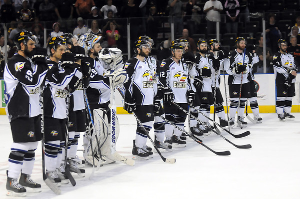 Colorado Eagles players look on as the Bossier-Shreveport Mudbugs are awarded the Ray Miron President's Cup Trophy after they beat the Eagles, 2-1, to become CHL champions on Friday, May 27, 2011 at the Budweiser Events Center in Loveland, Colo.