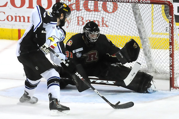 Rapid City Rush goalie Tim Boron stops a shot by Colorado Eagles winger Kevin Ulanski in the first period of their game Thursday, May 5, 2011 at the Budweiser Events Center in Loveland, Colo.