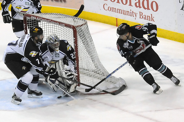 Bossier-Shreveport Mudbugs forward David Rutherford, right, tries to get the puck past Colorado Eagles goalie Kyle Jones and defenseman Joe Grimaldi in the first period of their game on Friday, May 27, 2011 at the Budweiser Events Center in Loveland, Colo.