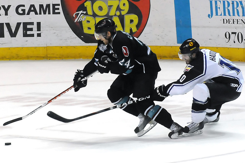 Bossier-Shreveport Mudbugs forward Nick Layton, left, skates away from Colorado Eagles player Steve Haddon in the first period of their game on Friday, May 13, 2011 at the Budweiser Events Center.