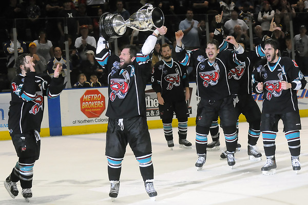 Bossier-Shreveport Mudbugs players cheer as Travis Clayton hoists the Ray Miron Presidents' Cup over his head after the Mudbugs defeated the Colorado Eagles, 2-1, in the Presidents' Cup Finals on Friday, May 27, 2011 at the Budweiser Events Center in Loveland, Colo.