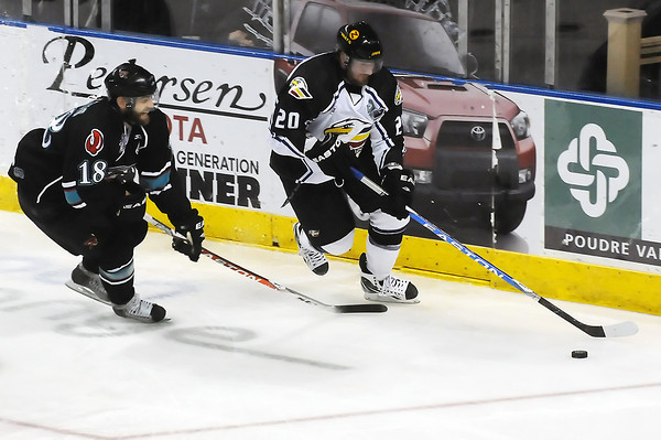 Colorado Eagles defenseman Jason Beatty, right, and Bossier-Shreveport Mudbugs winger Justin Aikins track down the puck against the boards in the first period of their game Wednesday, May 25, 2011 at the Budweiser Events Center in Loveland, Colo.