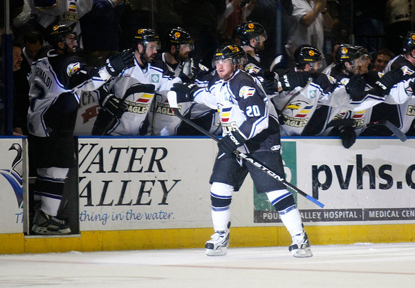 Colorado Eagles Jason Beatty slaps the hands of his team after scoring a goal Tuesday at the Budweiser Events Center in Loveland. (Photo by Gabriel Christus)