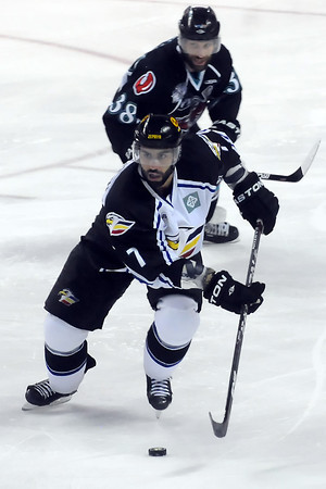 Colorado Eagles defenseman Joe Grimaldi (7) skates away from Bossier-Shreveport Mudbugs player Travis Clayton in the third period of their game on Friday, May 27, 2011 at the Budweiser Events Center in Loveland, Colo. The Eagles lost, 2-1.
