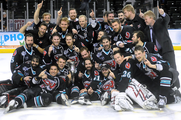 Bossier-Shreveport Mudbugs team members pose together with the Ray Miron Presidents' Cup after a 2-1 win over the Colorado Eagles to clinch the series 4-3 on Friday, May 27, 2011 at the Budweiser Events Center in Loveland, Colo.