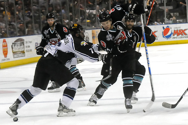 Colorado Eagles defenseman Joe Grimaldi, left, battles with Bossier-Shreveport Mudbugs forward David Rutherford in the first period of their game Wednesday, May 25, 2011 at the Budweiser Events Center in Loveland, Colo.