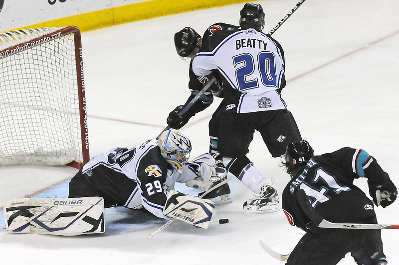 Colorado Eagles goalie Kyle Jones and defenseman Jason Beatty battle in front of the net with Bossier-Shreveport Mudbugs players Brett Smith, bottom right, and David Rutherford during the second period of their game on Friday, May 13, 2011 at the Budweiser Events Center.
