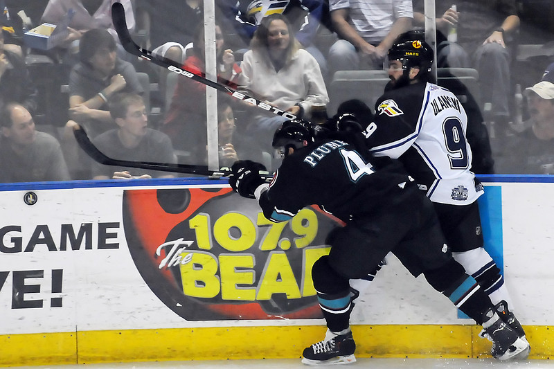 Colorado Eagles winger Kevin Ulanski, right, battles against the boards with Bossier-Shreveport Mudbugs defenseman Clay Plume in the third period of their game on Friday, May 27, 2011 at the Budweiser Events Center in Loveland, Colo.