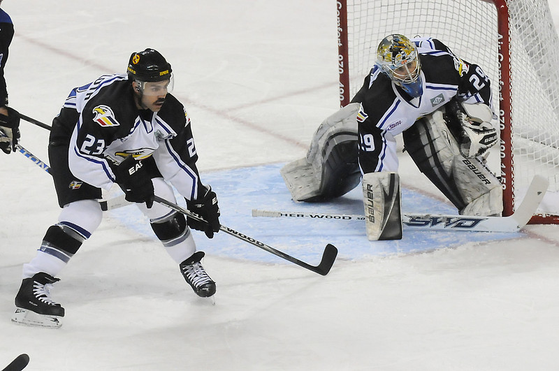 Colorado Eagles defenseman Aaron Schneekloth (23) and goalie Kyle Jones (29) in the first period of a game against the Wichita Thunder on Friday, Nov. 26, 2010 at the Budweiser Events Center.